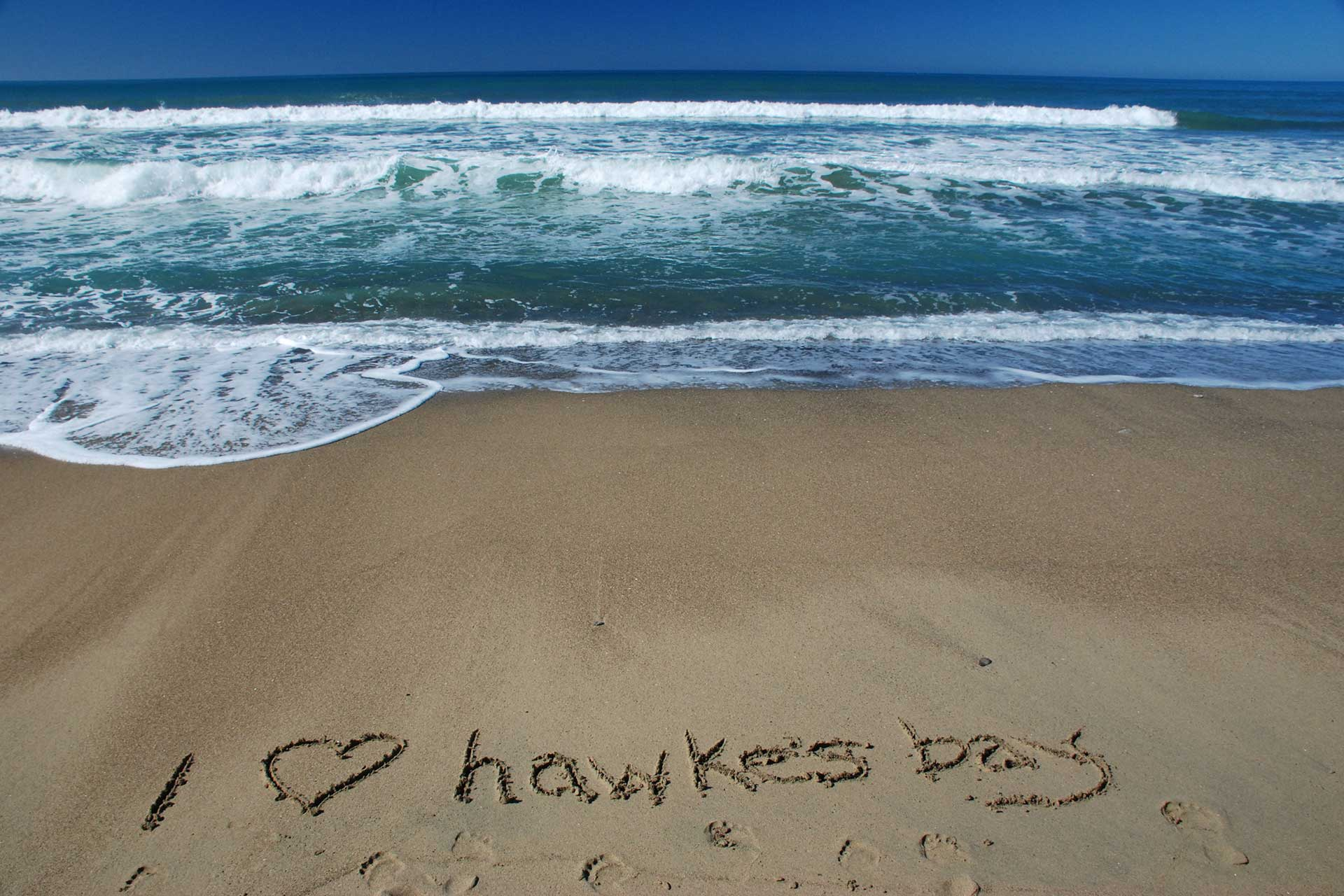 """Photo of """"I love Hawkes Bay beaches"""" drawn in the sand 
